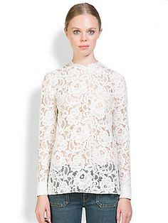 Saint Laurent Floral Lace TopA long-sleeved layering piece, crafted from romantic, beautifully rendered floral lace.  Round scalloped neckline Long sleeves Button cuffs Back keyhole with button closure Cotton/nylon/modal/rayon Dry clean Made in France This style runs true to size. We recommend ordering your usual size for a standa
