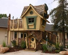 """Deluxe Upgraded Tommy's Turbo Terrace - $14,075.00  I can't believe the Keebler elves don't live in this playhouse. It's a wonderful, whimsical structure for kids.     13'6""""W x 9'D x 15'2""""H"""