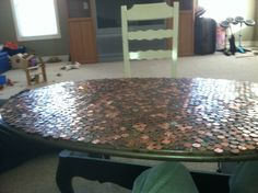 Ugly table turned fabulous.  This dated coffee table got a new life, a telescoping, shiny one.