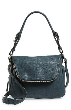 Modern curves define this spacious shoulder bag featuring a fold-over flap and lavishly textured faux-leather finish.
