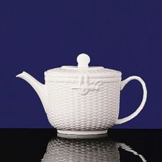 """This eclectic service with its beautifully-detailed basket-style relief is an """"everyday"""" white china for those who appreciate the unique. Bone china. 