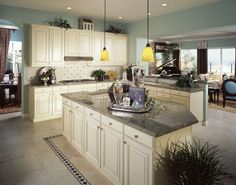 White kitchen in open concept great room.