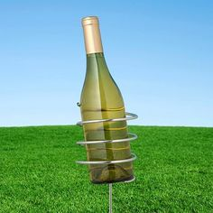 """Wine Bottle Holder Stake Wine Accessories by Wine Accessories. $10.00. Wine Bottle Holder Stake Wine Accessories. Stake Wine Bottle HolderEnjoy the great outdoors with a sumptuous picnic in the park. Stop fighting with the ground to find a flat spot to keep your wine from falling over. Use our Wine Bottle Holder Stake and Wine Glass Stakes to keep them off the ground but within easy reach. Simply stick them into the ground and enjoy.Measures 3.25"""" by 12.5""""H. Fits most st..."""