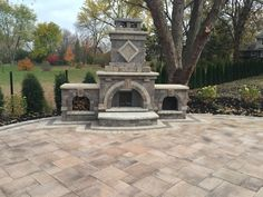 outdoor fireplace and brick patio