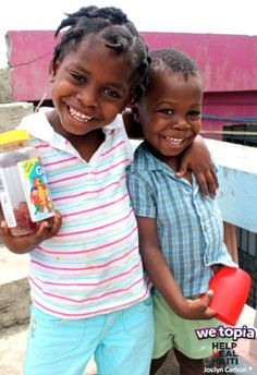 Elna (Age 4), and Kenny (Age 3), love the gummy vitamins provided by Help Heal Haiti and funded by gifts of Joy given in WeTopia