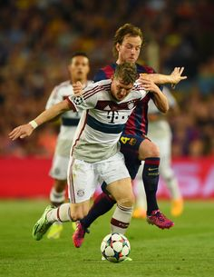 Bastian Schweinsteiger of Bayern München is challenged by Ivan Rakitic of Barcelona during the UEFA Champions League Semi Final, first leg match between FC Barcelona and FC Bayern München at Camp Nou on May 6, 2015 in Barcelona, Catalonia.