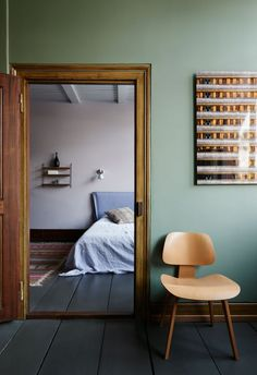 Kinfolk Book II, home, shades of grey and green, wall panels, wooden floors