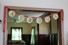 The Baby's name banner... the only thing not DIY, from loraleelewis.com  #red #yellow #babyshower #decor #retro #vintage