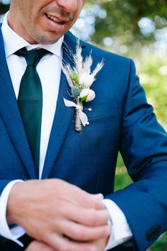 Fun and unique boutonniere with pampas grass