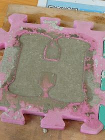 Cement H.  A puzzle piece out of the puzzle mat by Ella. Site not in English