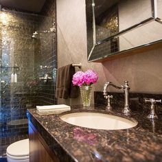 Make your guests feel special with a glamorous bathroom! A palette of chocolate brown mixed with burnished gold wall-covering makes this bathroom feel like a jewel box. #fashionableliving #seyiedesign #celebrity #interiorbranding #consumerexperience #luxuryliving #fashion #hollywoodlife #Beverlyhills #Brentwood #interiors #entertainwithstyle #fashionmeetsfunction #color #powderroom #contemporary