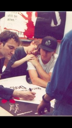 Quentin Tarantino and Tim Roth signing Reservoir Dogs posters at the Manhattan Beach Video Archives. Tim Roth & oldest Son Jack