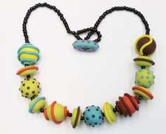 Example of working with limited color palette with polymer clay. Premo clay, glass beads. the beads are quite large, about inch diameter.