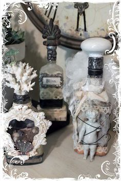 Any bottle embellished with found items and wired on whatevers, stained with food coloring and watered down glue, lace or old eyelet. Notice coral, old lamp final.