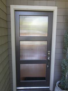 Love how the sidelights blend in with the door to make a statement ...