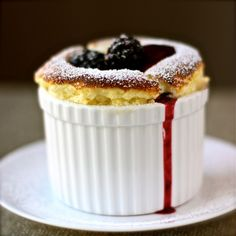 Lemon Souffle with Blackberry Sauce. Meyer Lemon Souffle with Blackberry Sauce Mini Desserts, No Bake Desserts, Just Desserts, Delicious Desserts, Yummy Food, Plated Desserts, Blackberry Sauce, Raspberry Sauce, Blackberry Recipes