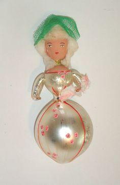 On Ebay...vintage lady Xmas ornament