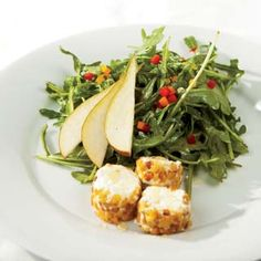 The pears and pine nut-crusted goat cheese make this arugula salad a meal on its own. Did we mention champagne vinaigrette?