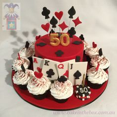A casino cake surrounded by cupcakes.