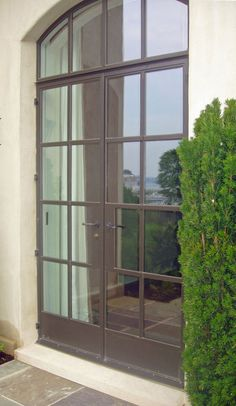 love these French doors - without the arched transom - but these are steel so too $$..  But like this look with all the glazing
