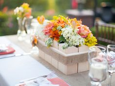 Colorful wedding floral centerpiece. Why not use plants in pots instead of cut flowers?