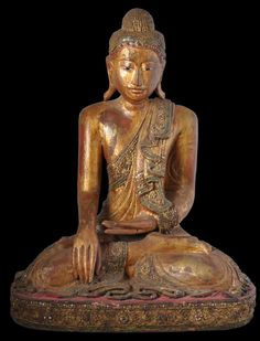 Seated Buddha, Lacquered & Gilded Wood, Mandalay, Burma; 19th century. This image of the Buddha is in a naturalistic style most probably prompted by colonial influences. It has been carved in wood, lacquered and gilded and inset with glass fragments backed with coloured foil (known as hman-zi- shwei-cha) and overlaid thayo work, a process whereby thin, rolled strands of lacquer and ash putty are applied in patterns. This and more important Asian art for sale on the CuratorsEye.com.