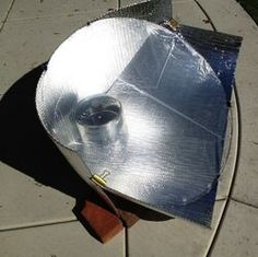 Windshield Shade Solar Cooker | Solar Cooking | Fandom Windshield Shade, Metal Coat Hangers, Solar Cooker, Solar Oven, Water Boiler, Solar Generator, Wire Frame, Wheelbarrow, Boy Scouts