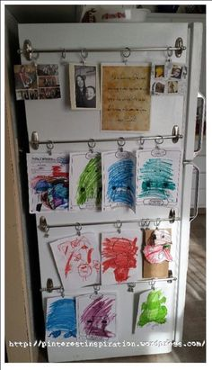 Kid Art Display with command hooks cool idea especially for apartment living! Not only great for art display, but those other things that always seem to clutter up the kitchen/fridge. Kids Art Galleries, Command Hooks, Command Strips, Command Hook Curtain Rod, Tension Rod Curtains, Magnetic Curtain, Artwork Display, Art Wall Kids Display, Displaying Kids Artwork