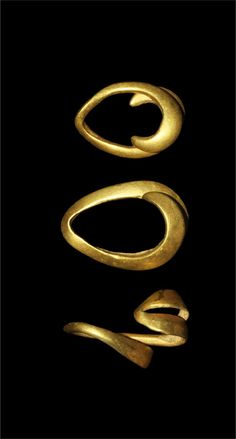BRONZE AGE GOLD HAIR RINGS Circa 1,000-500 BC. A set of three gold concave D-section loops with recurved ends, used as a hair decoration. Gold, 4.12 gra