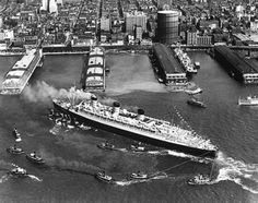 S.S. Queen Mary docking in New York City. 1938. From the New York State Archives.