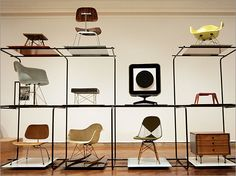 eames chairs are great for small apartments. your friends will feel special when you invite them to sit.