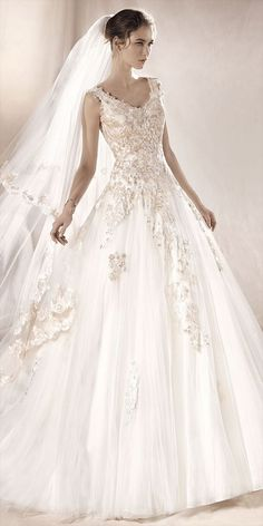 7d63a6d11cd Romantic princess wedding dress in tulle with elegant floral inspired  appliqués in thread embroidery and gemstone