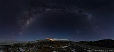 Cosmic convergence!  New Zealand's beloved Mt. Ruapehu and three galaxies (Milky Way, Large & Small Magellanic clouds) .  It looks as if Mt. Ruapehu is erupting ... but it's really light reflected by the low clouds near the mountain.  Photo taken June 23 by Manoj Kesavan ( http://on.fb.me/1IjGphT)