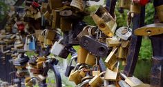 Padlocks, affixed to a bridge by sweethearts, in Venice, Rome, Verona, Florence, and other cities