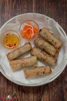 Authentic Vietnamese Fried Spring Rolls - These spring rolls or egg rolls are filled with a pork and prawn filling before they are deep-fried.