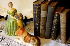 old books with vintage knick knacks. You can find plenty of old books and knick knacks at Nifty Thrifty