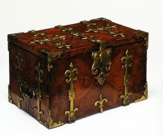 Strong box, England, 1680-1700. Kingwood veneered on pine, with iron and gilt-brass mounts.