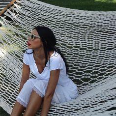 Ingrid Vlasov,relaxing ina ahammock,sunglasses,summer,white skirt