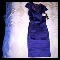 Jax Dress Purple Satin, Stretch.  Fully lined, knee length.  In different lighting the dress looks violet to a shade of blue. Jax   Dresses