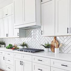 Home Decor Recibidor Basic White Polished Ceramic Wall Tile Kitchen Design. Well, nothing beats an all-white kitchen with a simple twist like a herringbone backsplash, amirite. Backsplash For White Cabinets, White Kitchen Cabinets, Kitchen Redo, Home Decor Kitchen, Kitchen Interior, New Kitchen, Home Kitchens, Kitchen Remodel, White Subway Tile Backsplash