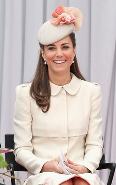 We're swooning over the Jane Taylor peach and cream fascinator Kate wore Aug. 4, 2014 to the WWI 100 Years commemoration ceremony in Liege, Belgium. Seriously, where can we find that hat?!?!  - GoodHousekeeping.com