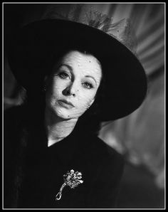 Vivien Leigh in suit and veiled hat by Madeleine de Rauch, earings and brooch by Cartier, photo by Cecil Beaton for Vogue, Paris, November 19, 1944