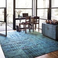 "Flor carpet tiles ""remembrance"" in teal. Maybe the only carpet we could ever have in the living room with all our pets!"