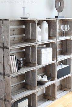 have a few...but need more for a shelf in the craft room/office! Well mine are vintage food boxes and a couple of old  plastic milk crates....like the even-ness of it all...just need MORE!