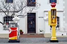The cute coffee shop and petrol station in main road Matjiesfontein. From the (supposedly) haunted Lord Milner Hotel to the museums and red bus tour - what to do in the tiny Victorian village of Matjiesfontein in South Africa's Western Cape. Safari, Cute Coffee Shop, Victorian Village, Red Bus, Interesting History, Store Design, Museums, South Africa, Cape