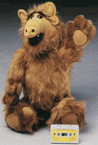 Talking Alf, He had a built in cassette player inside on his back his mouth moved in sync with the tape his ears and eyebrows moved, I had this but I broke his ears of shortly after I got him for christmas because I got mad at my dad and threw it.