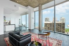 Shop This Look: Modern Penthouse With City Views >> http://photos.hgtv.com/rooms/viewer/living-space/living-room/modern/modern-penthouse-living-room-with-city-views?soc=pinterest