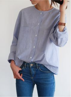I like these buttoned blouses w/o collars. The color is nice too.
