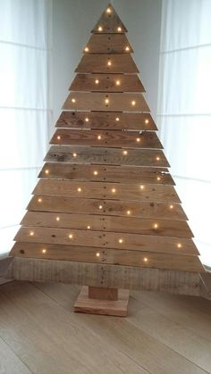 Why You Should Let Your Kids Make Their Own Christmas Decorations - Get Ready for ChristmasDIY outdoor wooden pallet Christmas trees with lightsTeak garden tablesSquare teak table 180 black Jan KurtzJan KurtzReduced solid wood coffee Pallet Wood Christmas Tree, Pallet Tree, Driftwood Christmas Tree, Wooden Christmas Decorations, Diy Christmas Tree, Outdoor Christmas, Rustic Christmas, Christmas Projects, Holiday Crafts