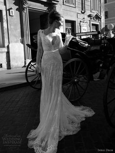 Inbal Dror - long sleeve lace gown with scalloped neckline.